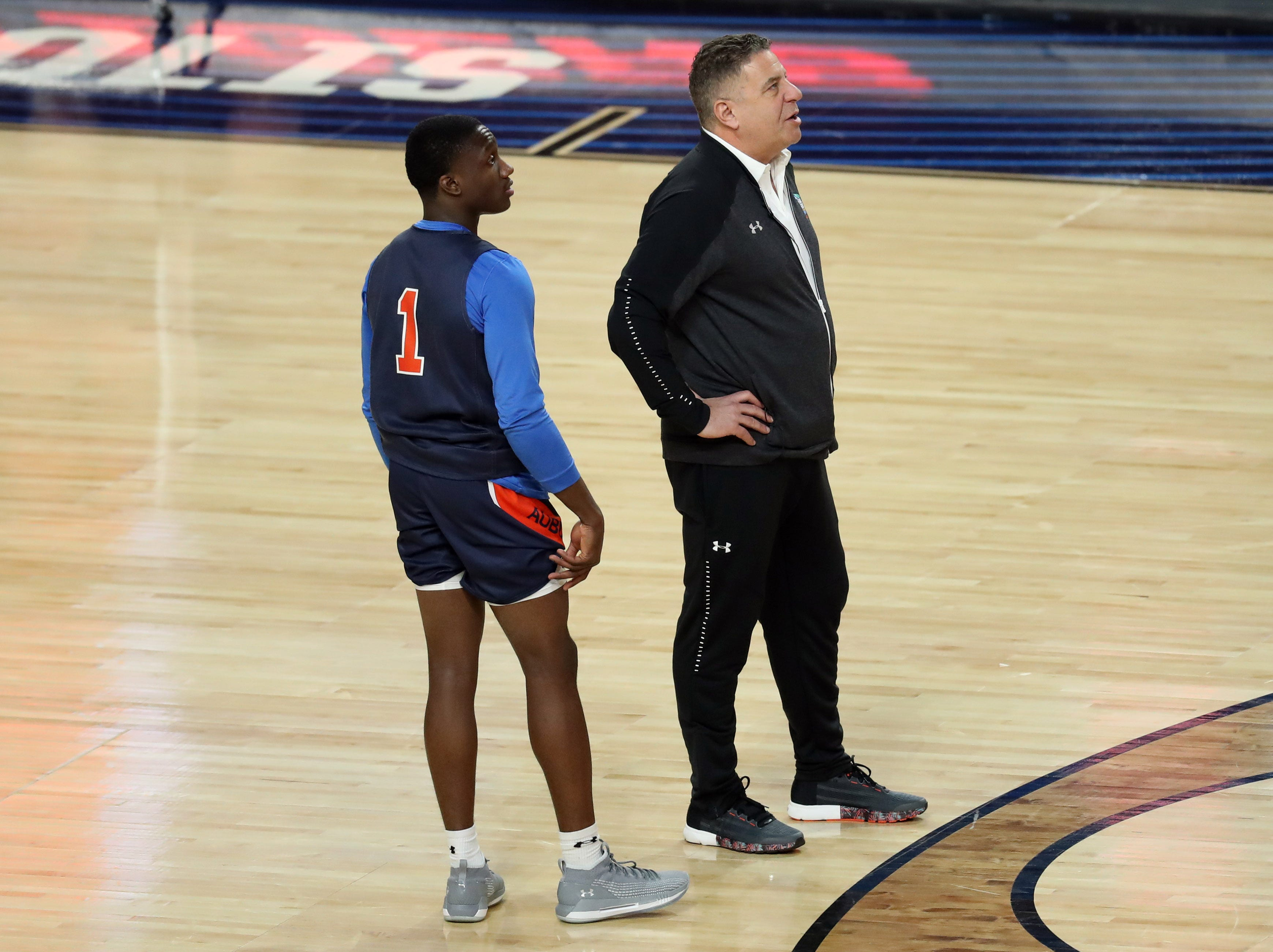 Apr 5, 2019; Minneapolis, MN, USA; Auburn Tigers guard Jared Harper (1) and head coach Bruce Pearl look on during practice for the 2019 men's Final Four at US Bank Stadium. Mandatory Credit: Brace Hemmelgarn-USA TODAY Sports