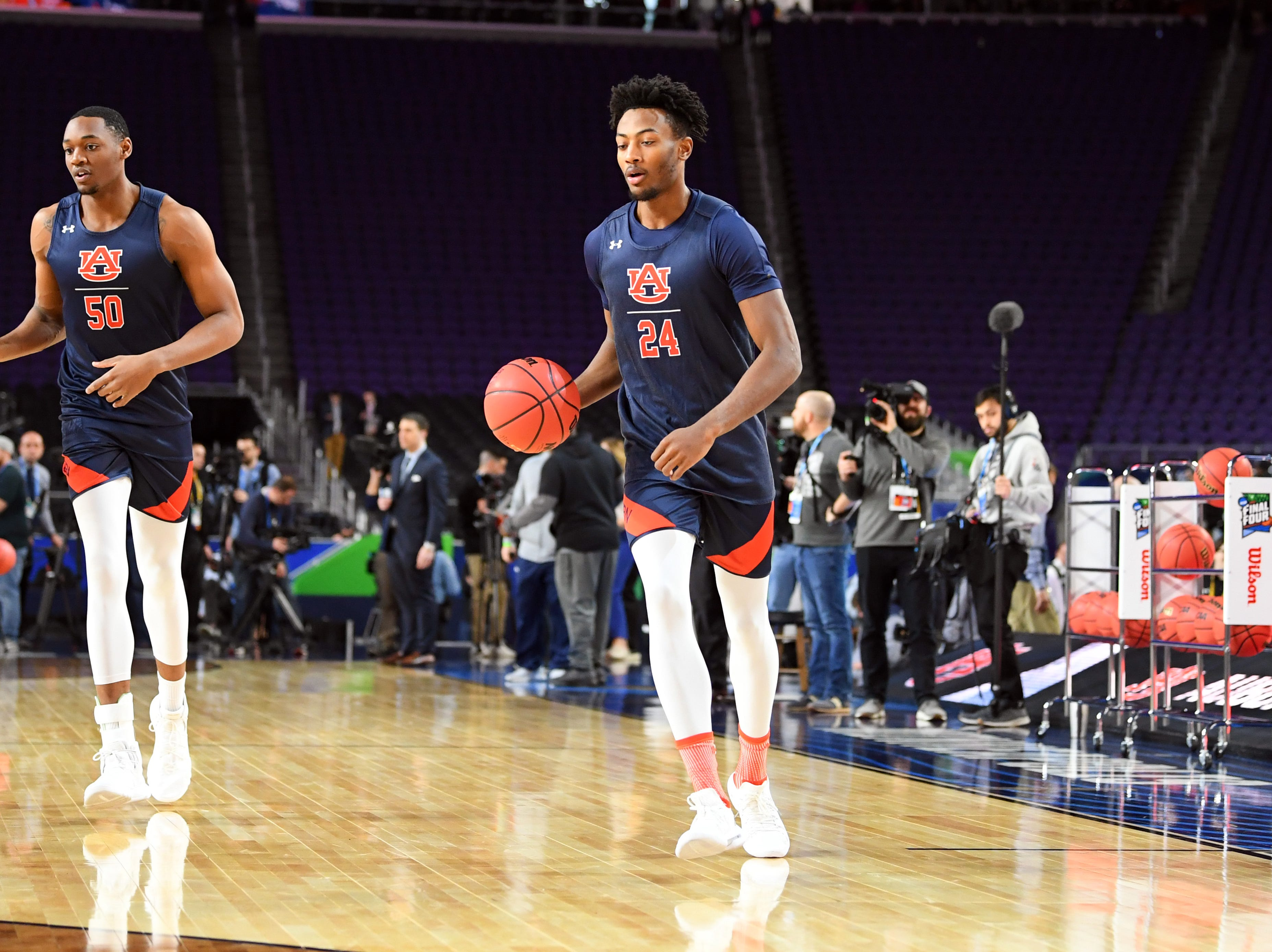 Apr 5, 2019; Minneapolis, MN, USA; Auburn Tigers center Austin Wiley (50) and Anfernee McLemore (24)during practice for the 2019 men's Final Four at US Bank Stadium. Mandatory Credit: Bob Donnan-USA TODAY Sports