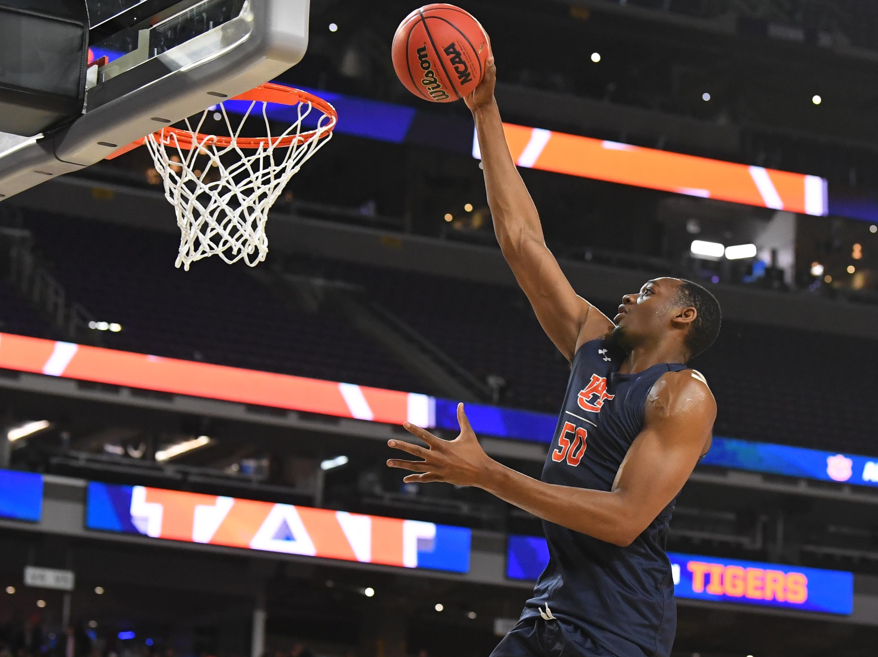 Apr 5, 2019; Minneapolis, MN, USA; Auburn Tigers center Austin Wiley (50) shoots during practice for the 2019 men's Final Four at US Bank Stadium. Mandatory Credit: Robert Deutsch-USA TODAY Sports