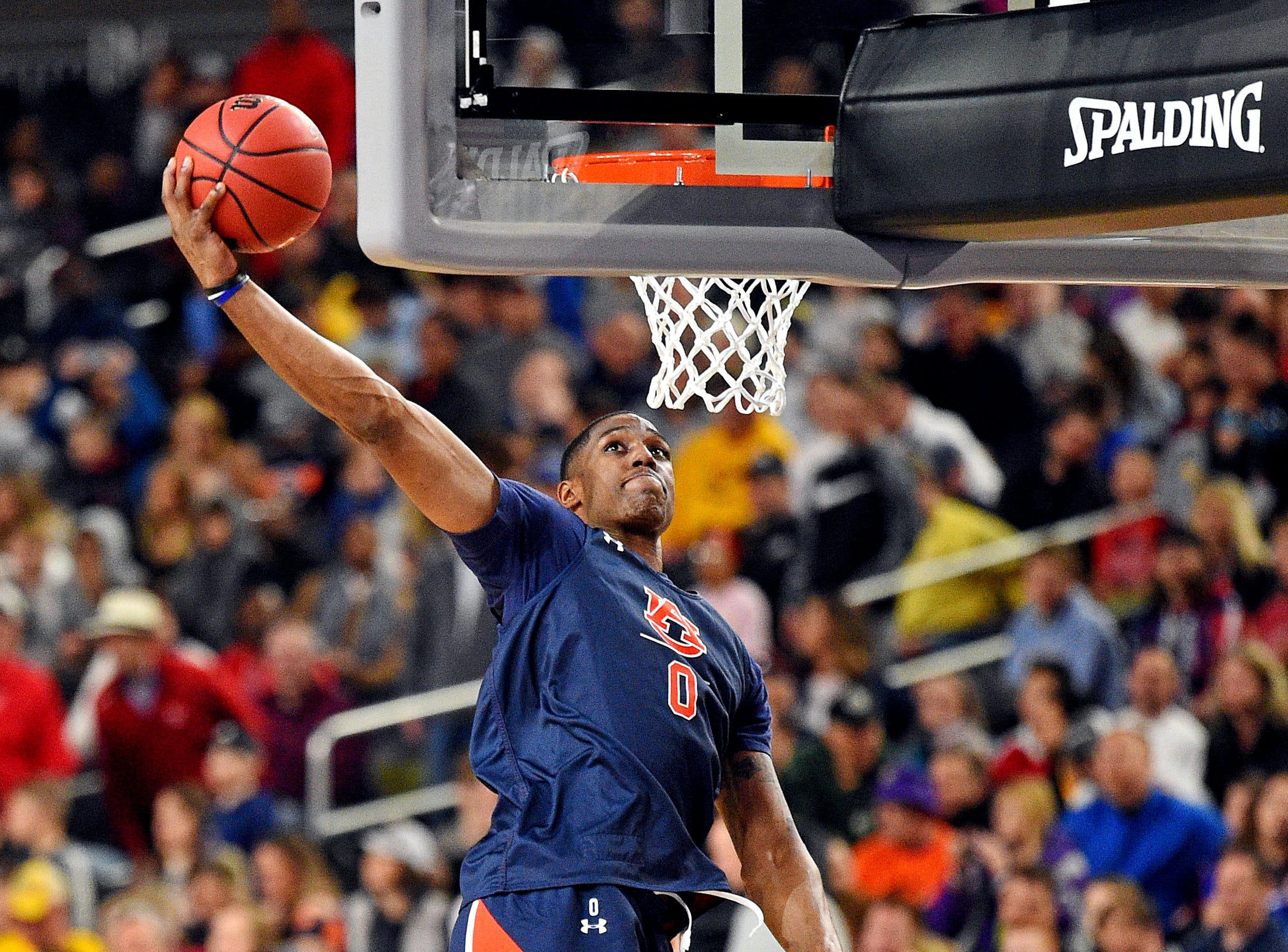 Apr 5, 2019; Minneapolis, MN, USA; Auburn Tigers forward Horace Spencer (0) dunks the ball during practice for the 2019 men's Final Four at US Bank Stadium. Mandatory Credit: Bob Donnan-USA TODAY Sports