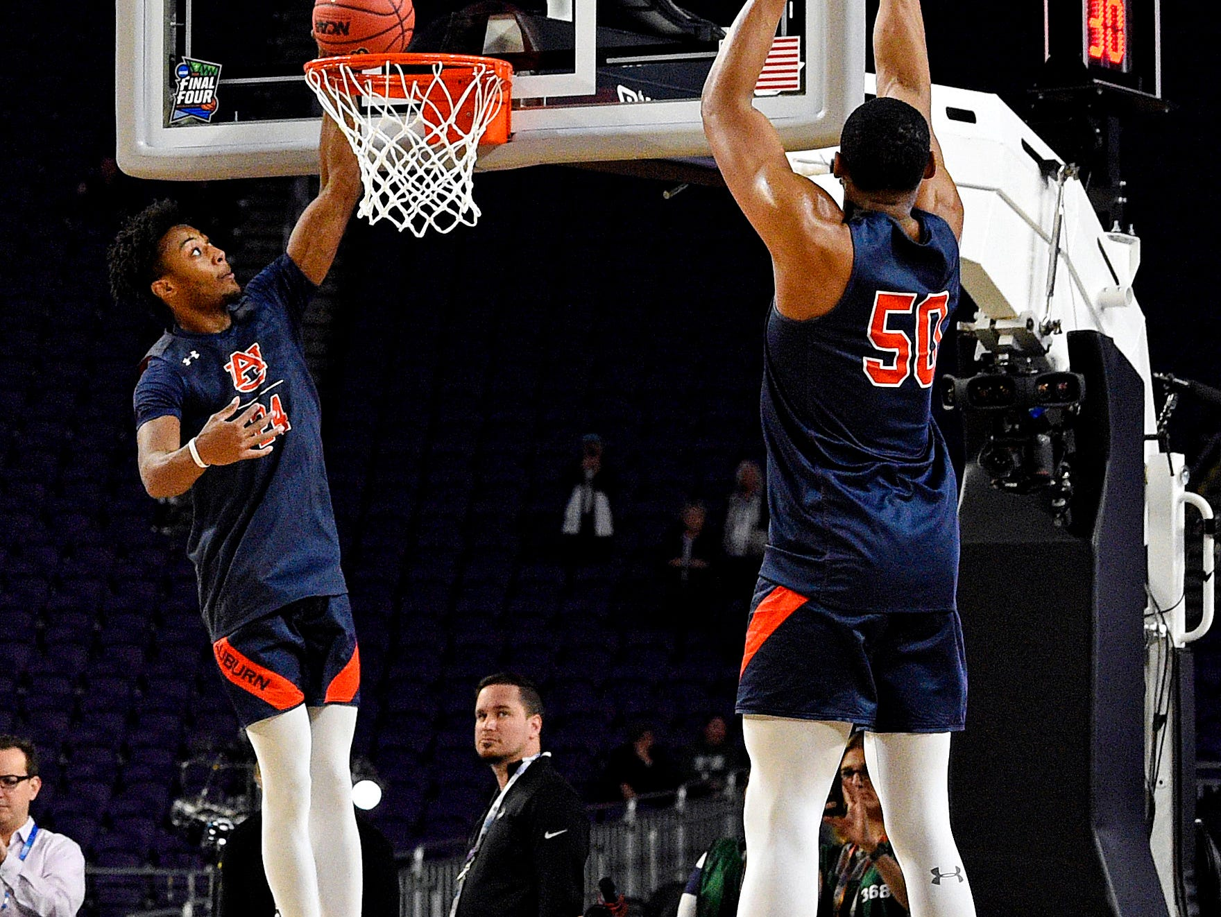 Apr 5, 2019; Minneapolis, MN, USA; Auburn Tigers forward Anfernee McLemore (24) and Auburn Tigers center Austin Wiley (50) shoots the ball during practice for the 2019 men's Final Four at US Bank Stadium. Mandatory Credit: Bob Donnan-USA TODAY Sports