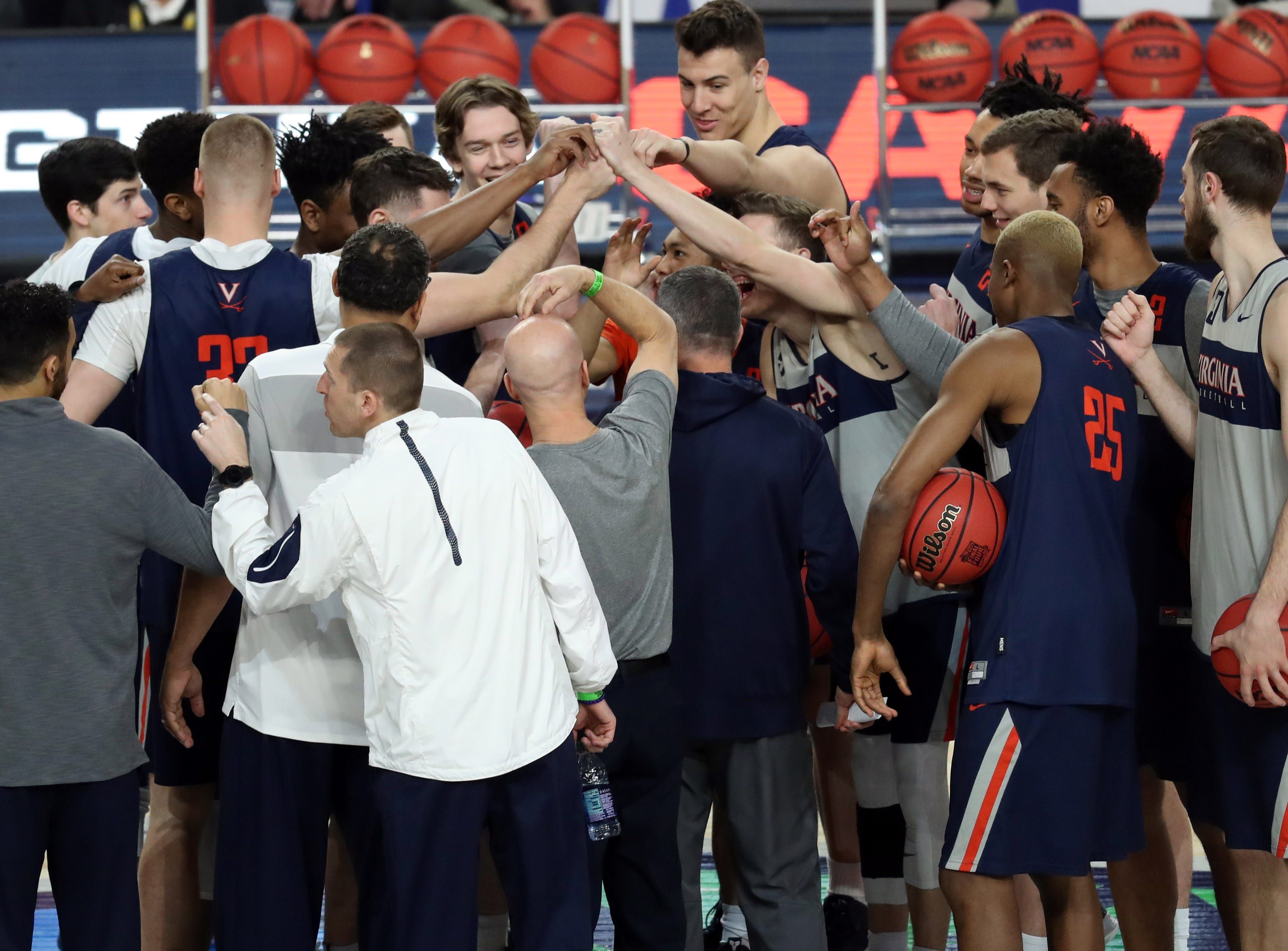 Apr 5, 2019; Minneapolis, MN, USA; The Auburn Tigers meet at center court after practice for the 2019 men's Final Four at US Bank Stadium. Mandatory Credit: Brace Hemmelgarn-USA TODAY Sports