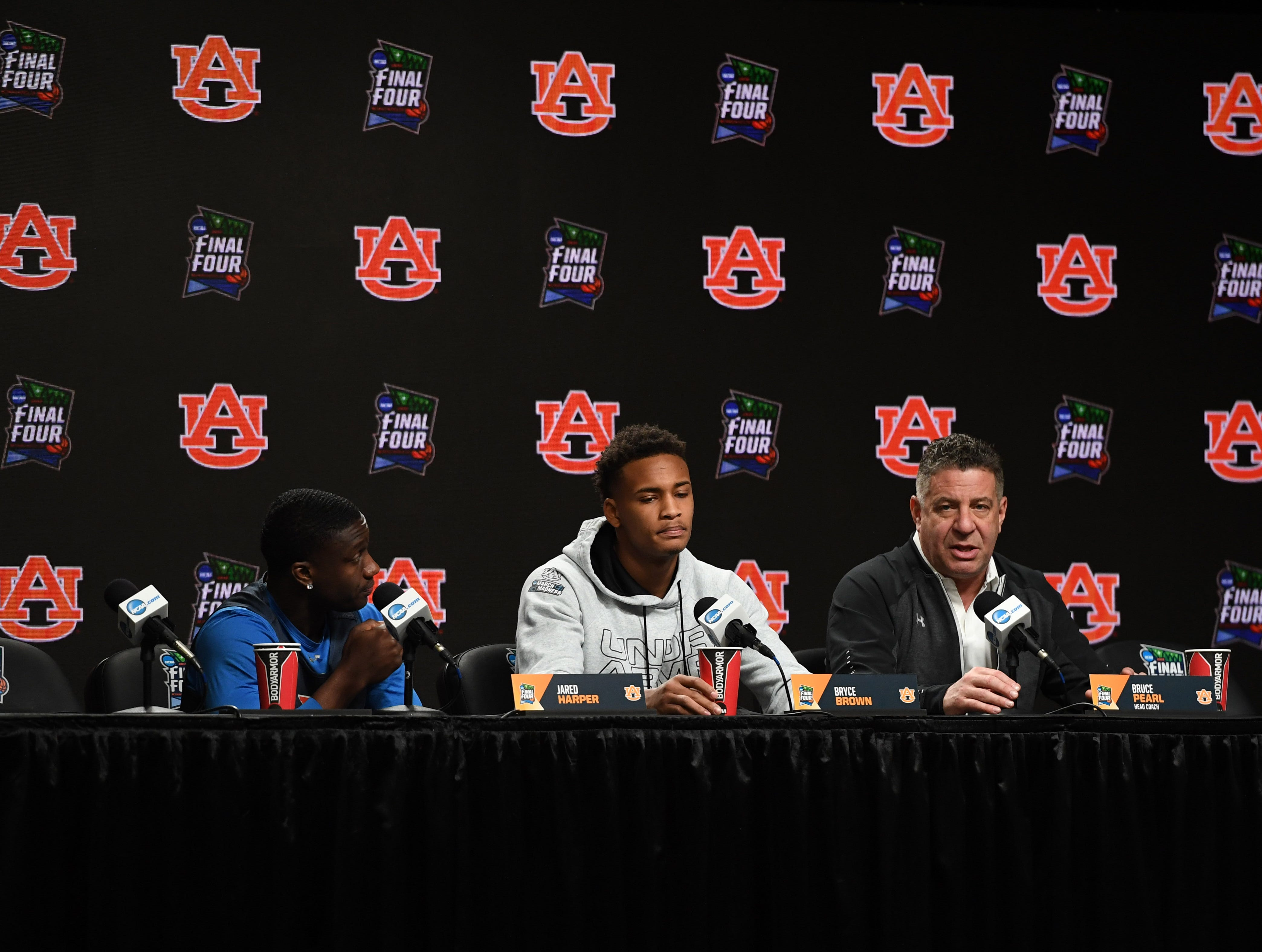 Apr 5, 2019; Minneapolis, MN, USA; Auburn Tigers guard Jared Harper (1) guard Bryce Brown (2) head coach Bruce Pearl during a press conference before practice for the 2019 men's Final Four at US Bank Stadium. Mandatory Credit: Shanna Lockwood-USA TODAY Sports