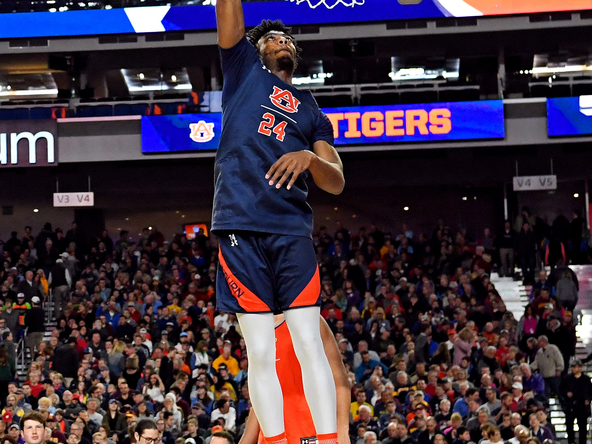 Apr 5, 2019; Minneapolis, MN, USA; Auburn Tigers forward Anfernee McLemore (24) dunks the ball during practice for the 2019 men's Final Four at US Bank Stadium. Mandatory Credit: Bob Donnan-USA TODAY Sports