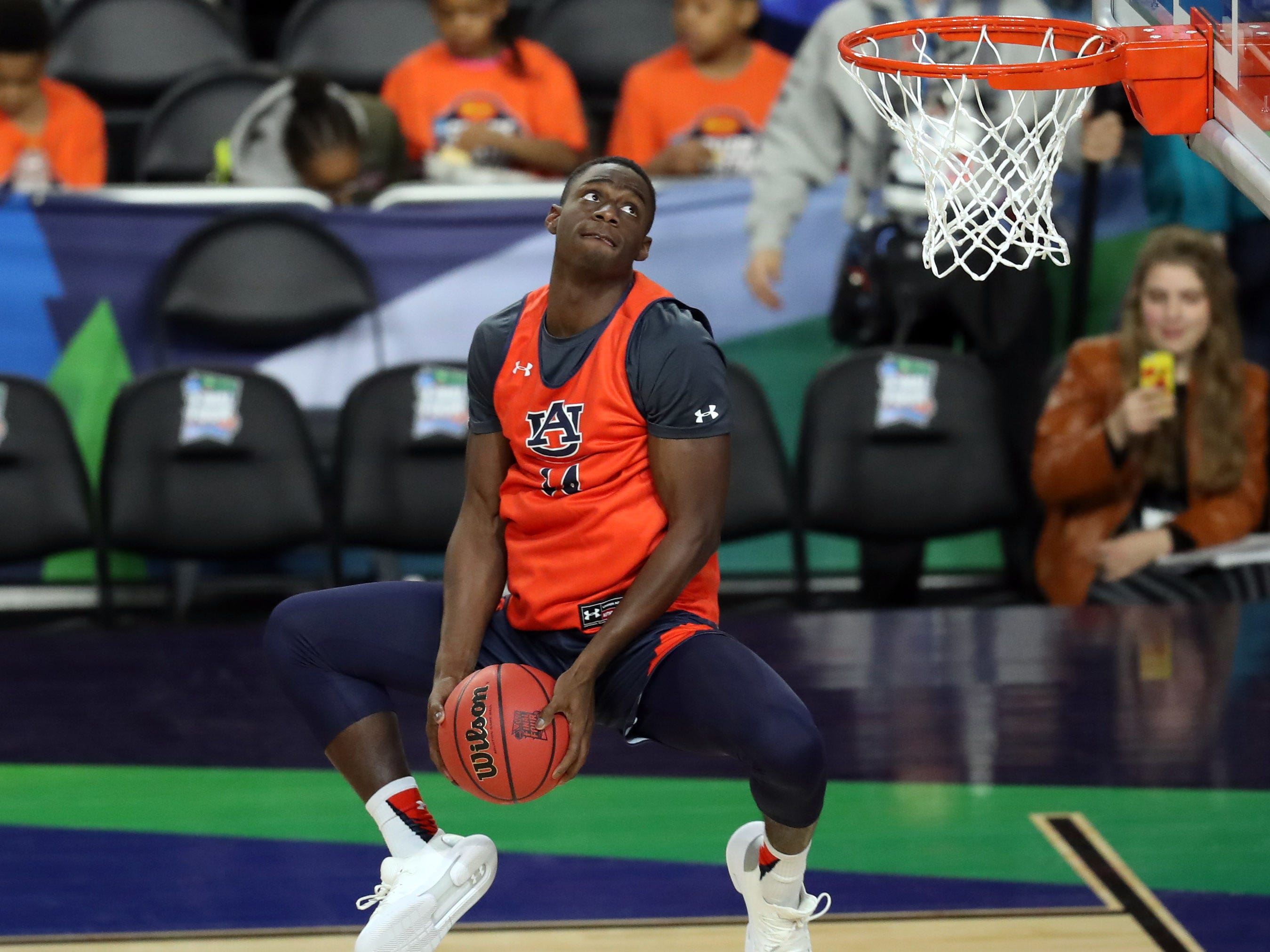 Apr 5, 2019; Minneapolis, MN, USA; Auburn Tigers guard Preston Cook (14) dunks the ball during practice for the 2019 men's Final Four at US Bank Stadium. Mandatory Credit: Brace Hemmelgarn-USA TODAY Sports