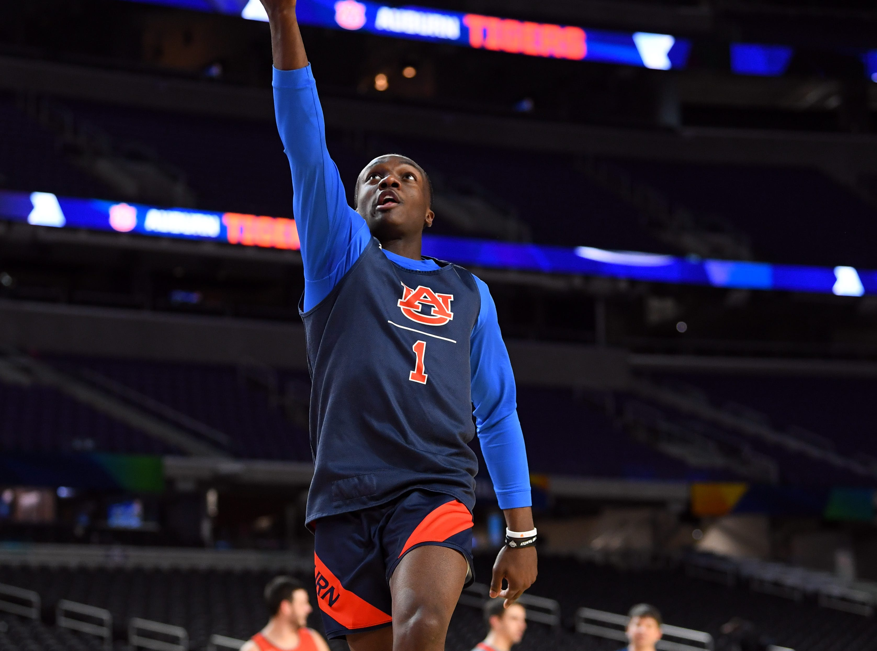 Apr 5, 2019; Minneapolis, MN, USA; Auburn Tigers guard Jared Harper (1) performs a lay up during practice for the 2019 men's Final Four at US Bank Stadium. Mandatory Credit: Bob Donnan-USA TODAY Sports