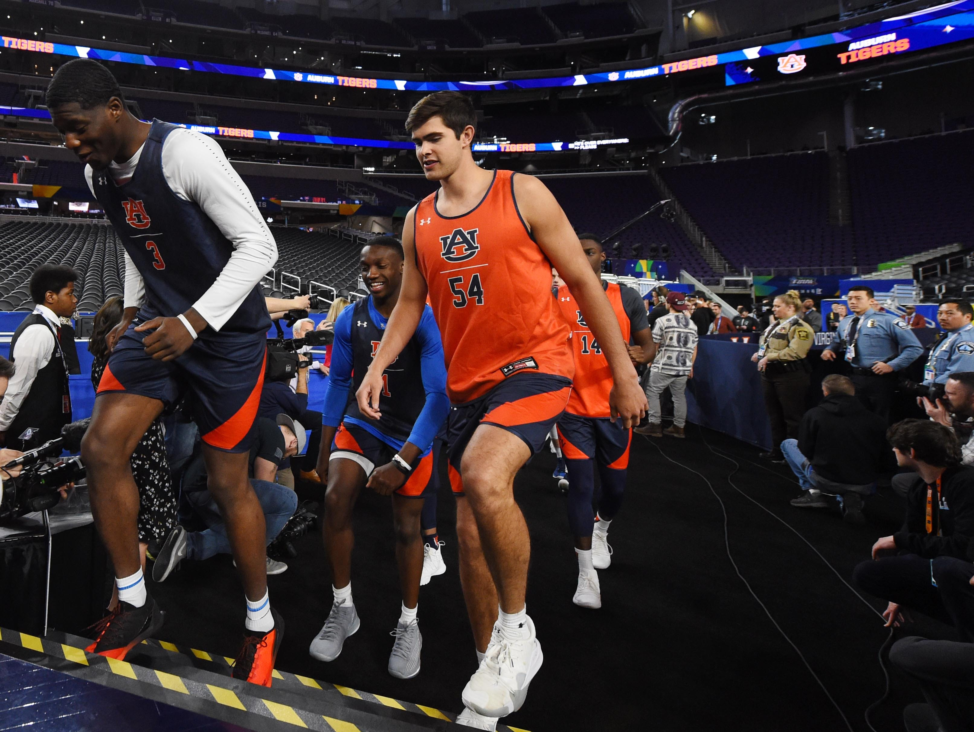 Apr 5, 2019; Minneapolis, MN, USA; Auburn Tigers forward Danjel Purifoy (3) and forward Thomas Collier (54) head to the court during practice for the 2019 men's Final Four at US Bank Stadium. Mandatory Credit: Robert Deutsch-USA TODAY Sports