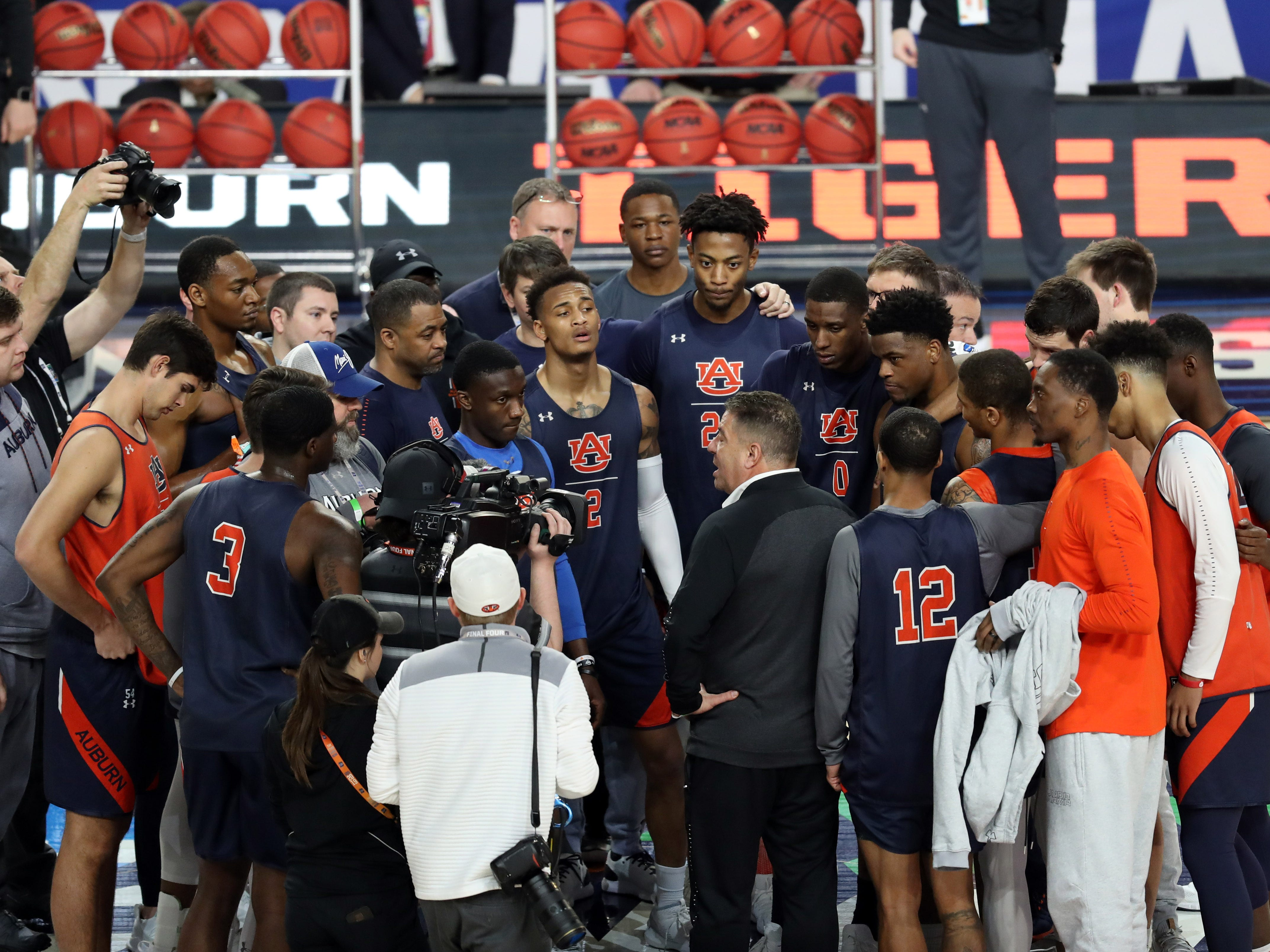 Auburn coach Bruce Pearl (center) speaks to his team during practice before the Final Four at U.S. Bank Stadium on Friday, April 5, 2019, in Minneapolis.