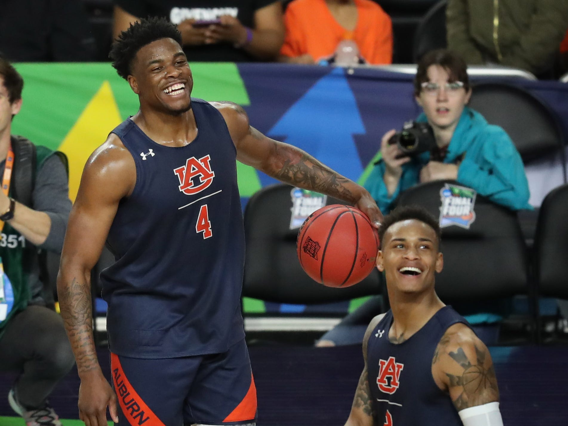 Apr 5, 2019; Minneapolis, MN, USA; Auburn Tigers guard Malik Dunbar (4) and guard Bryce Brown (2) smile during practice for the 2019 men's Final Four at US Bank Stadium. Mandatory Credit: Brace Hemmelgarn-USA TODAY Sports
