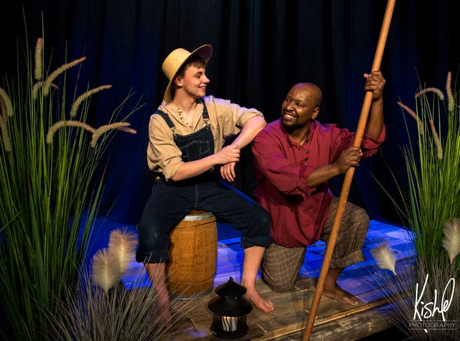 """Caid Brady plays Huck Finn and Jeffrey L. Jackson plays Jim in Muncie Civic Theatre's production of """"Big River."""""""