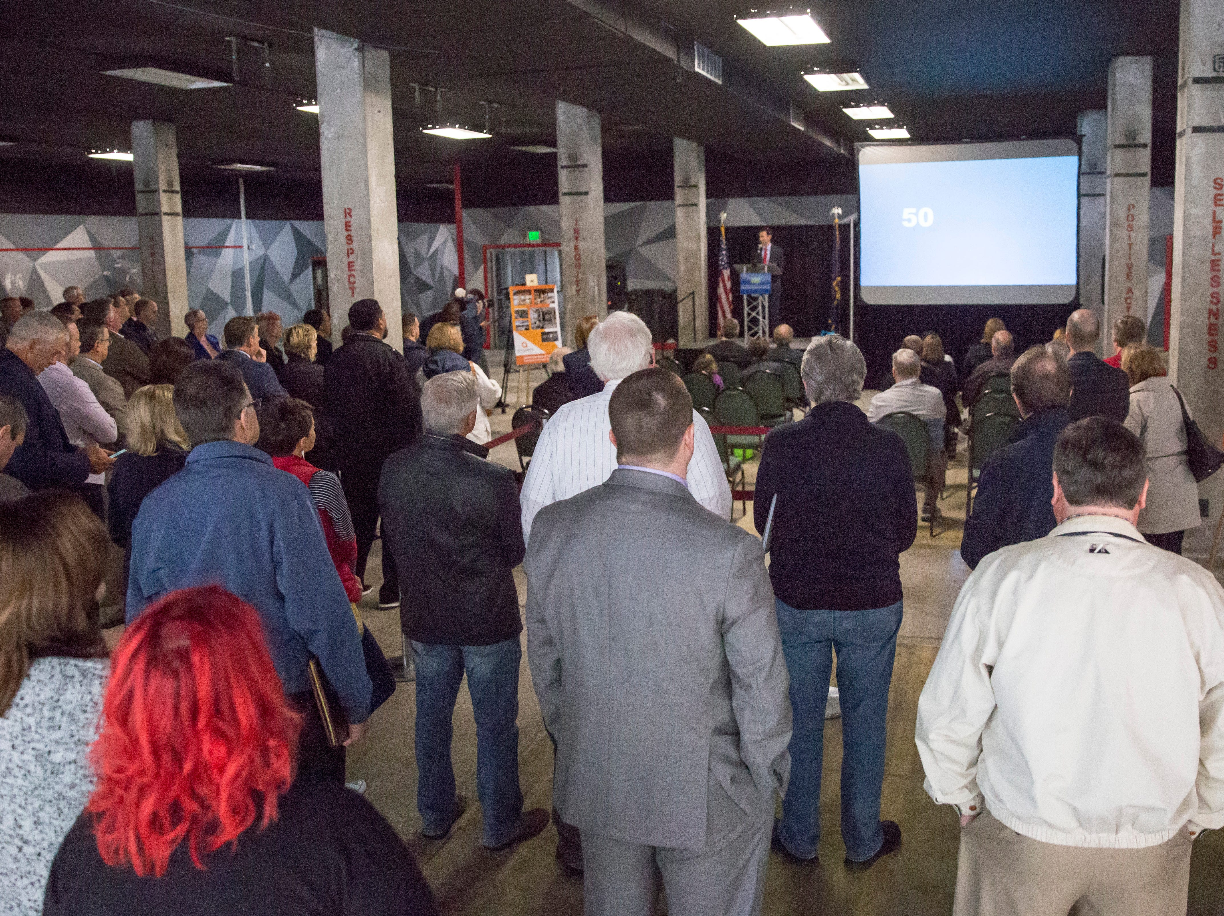 City officials and members of the community gather for the announcement that Accutech Systems would be moving their headquarters to downtown Muncie. The company, which will spend $5.5 million on the investment, hopes to be in their office by the end of the year.