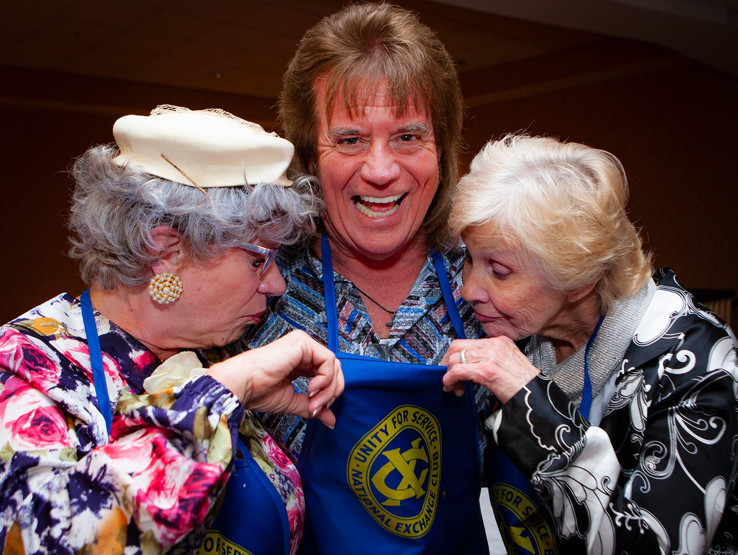 "The Church Lady, left, and Ronnie Stoneman from ""Hee Haw"" fame check out Tim Atwood at the Exchange Club Celebrity Waiter lunch."