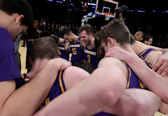 Lipscomb huddles in prayer after their 66 to 81 loss against Texas in the NIT Championship Game at Madison Square Garden Thursday, April 4, 2019 in New York, N.Y.