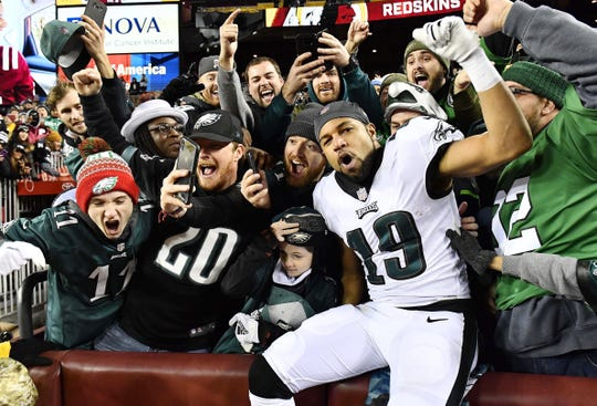 Philadelphia Eagles receiver Golden Tate celebrates with fans after the 24-0 win over the Washington Redskins at FedEx Field Dec. 30, 2018.