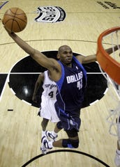 Dallas Mavericks' Jerry Stackhouse (42) prepares to dunk against the San Antonio Spurs in the first half  in Game 5 of the NBA Western Conference semifinals on May 17, 2006.