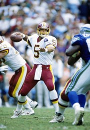 Redskins quarterback Heath Shuler (5) in action against the Seahawks on Sept. 4, 1994, at RFK Stadium.