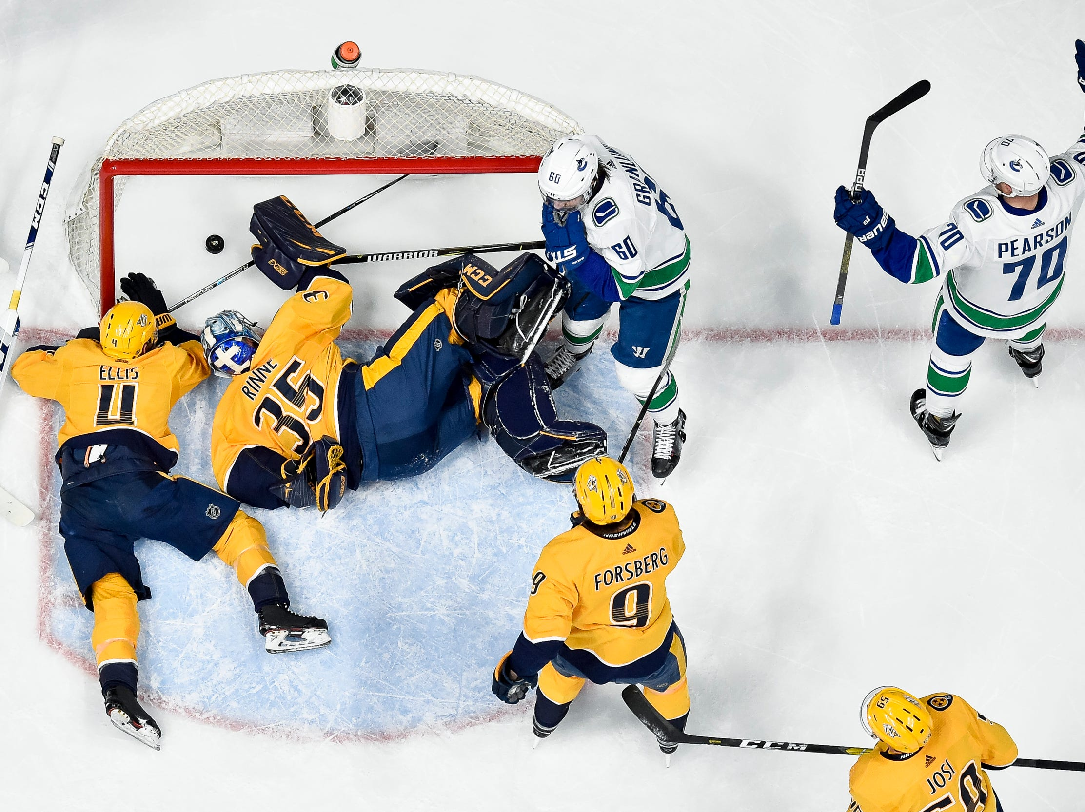 Vancouver Canucks left wing Tanner Pearson (70) reacts to scoring past Nashville Predators goaltender Pekka Rinne (35) during the first period at Bridgestone Arena in Nashville, Tenn., Thursday, April 4, 2019.