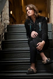 """Brandi Carlile at the Ryman Auditorium on April 3 in Nashville. """"I've never felt so much like I have a real shot of weaving myself into the musical landscape of this country, and I'm really aware of it and I'm not going to waste a single second,"""" Carlile says."""