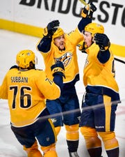 April 4, 2019 - Predators 3, Canucks 2: Nashville Predators center Ryan Johansen (92) reacts to scoring the game-winning goal against the Vancouver Canucks with defenseman P.K. Subban (76) and right wing Viktor Arvidsson (33) during the third period at Bridgestone Arena in Nashville, Tenn., Thursday, April 4, 2019.