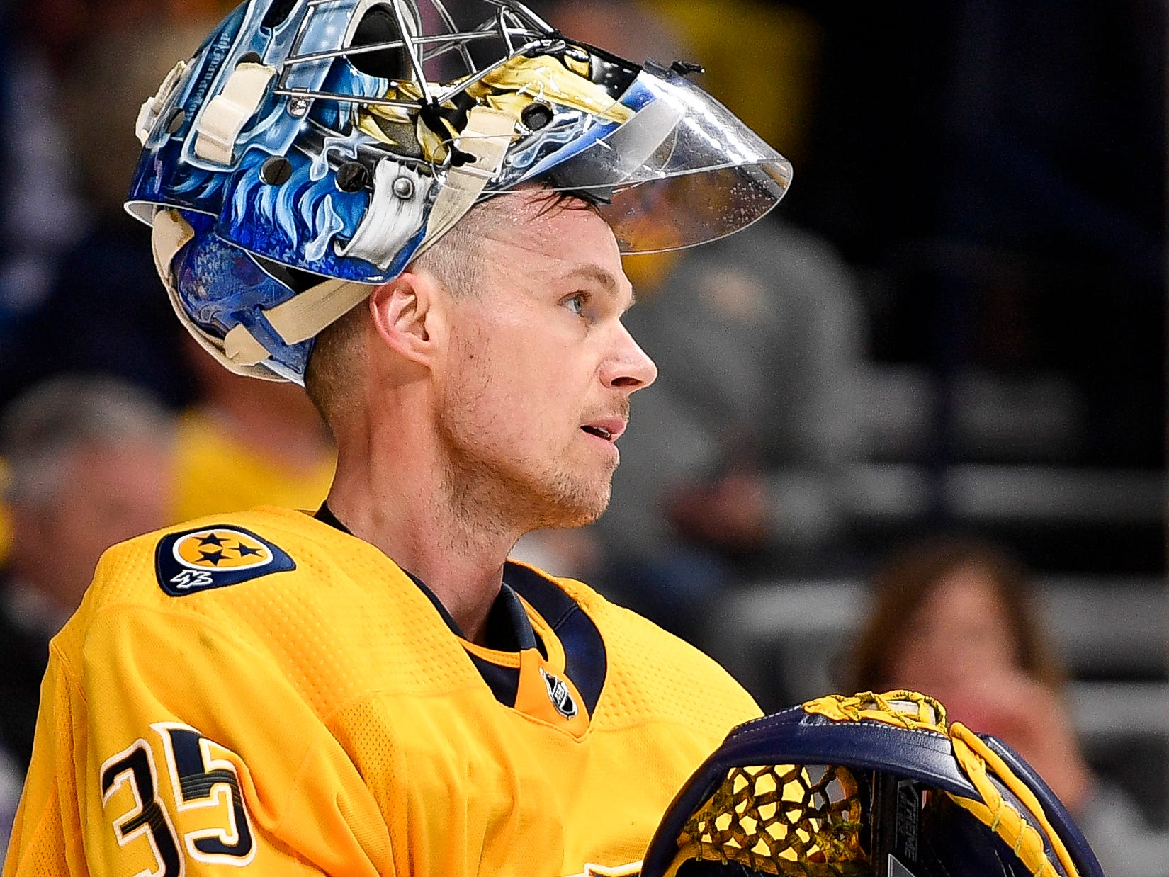 Nashville Predators goaltender Pekka Rinne (35) waits for gameplay to resume during the second period against the Vancouver Canucks at Bridgestone Arena in Nashville, Tenn., Thursday, April 4, 2019.