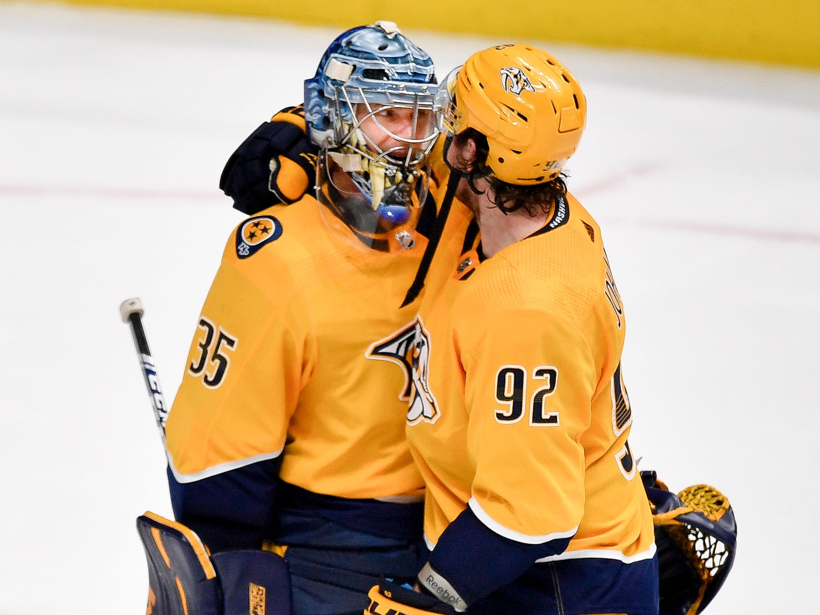 Nashville Predators center Ryan Johansen (92) celebrates defeating the Vancouver Canucks with goaltender Pekka Rinne (35) at Bridgestone Arena in Nashville, Tenn., Thursday, April 4, 2019.