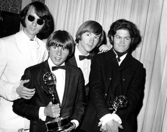 This June 4, 1967 file photo shows, from left, Mike Nesmith, Davy Jones, Peter Tork, and Micky Dolenz of The Monkees posing with their Emmy award for best comedy series at the 19th Annual Primetime Emmy Awards in Los Angeles.