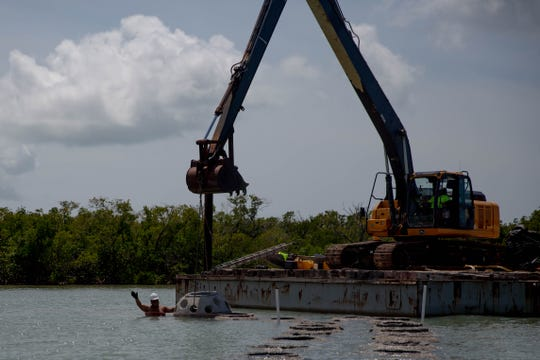Construction on the artificial reef project in Naples on April 5, 2019. Due to the loss of natural reefs in the Naples Bay, the city is conducting an artificial reef project.