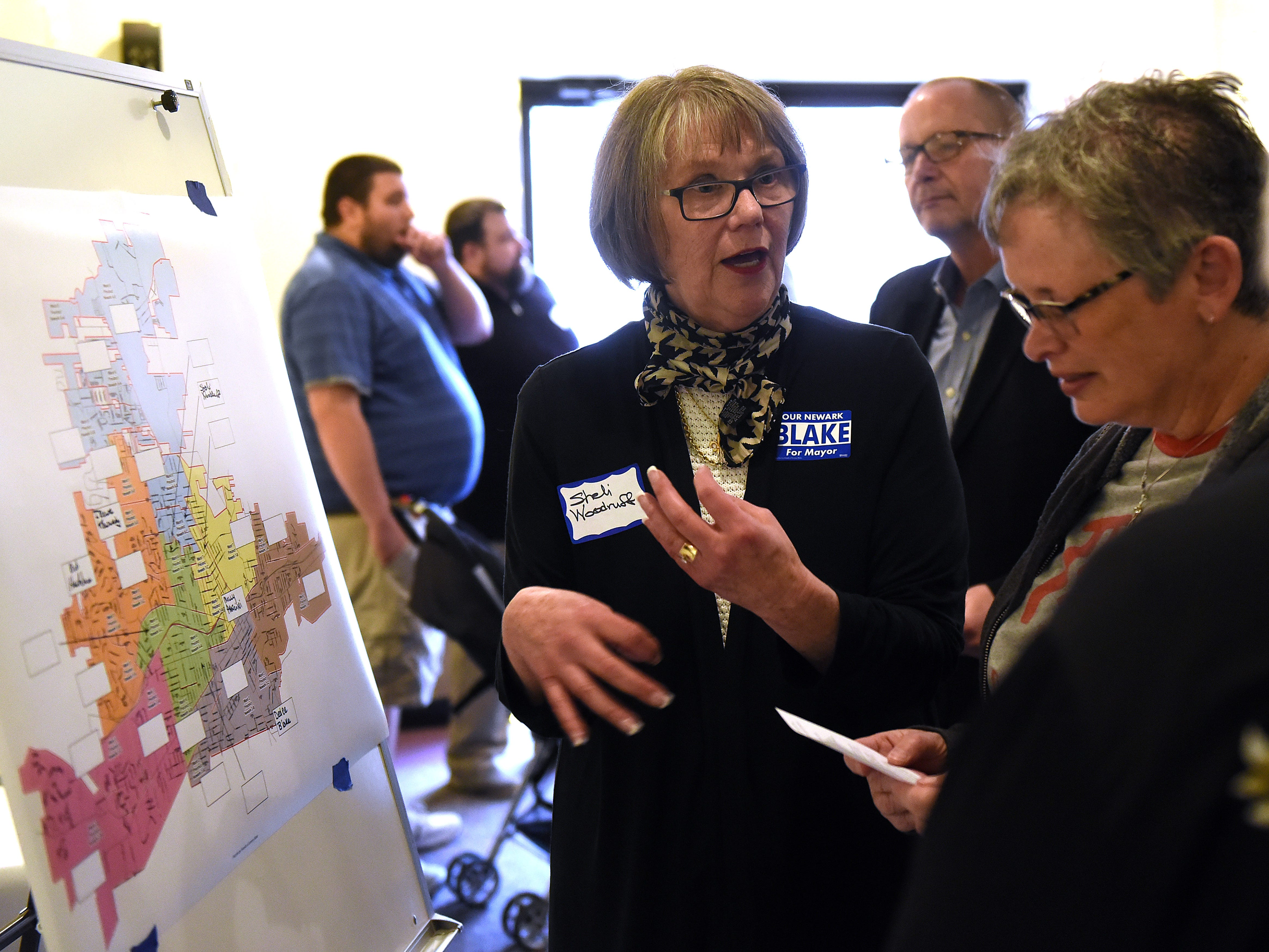 Sheli Woodruff, a precinct captain for part of Newark's sixth ward, discusses volunteering for City Councilman Jeremy Blake's campaign for mayor with Beth Schorr during a campaign kickoff event on Thursday, April 4, 2019 at The Grove by the River.