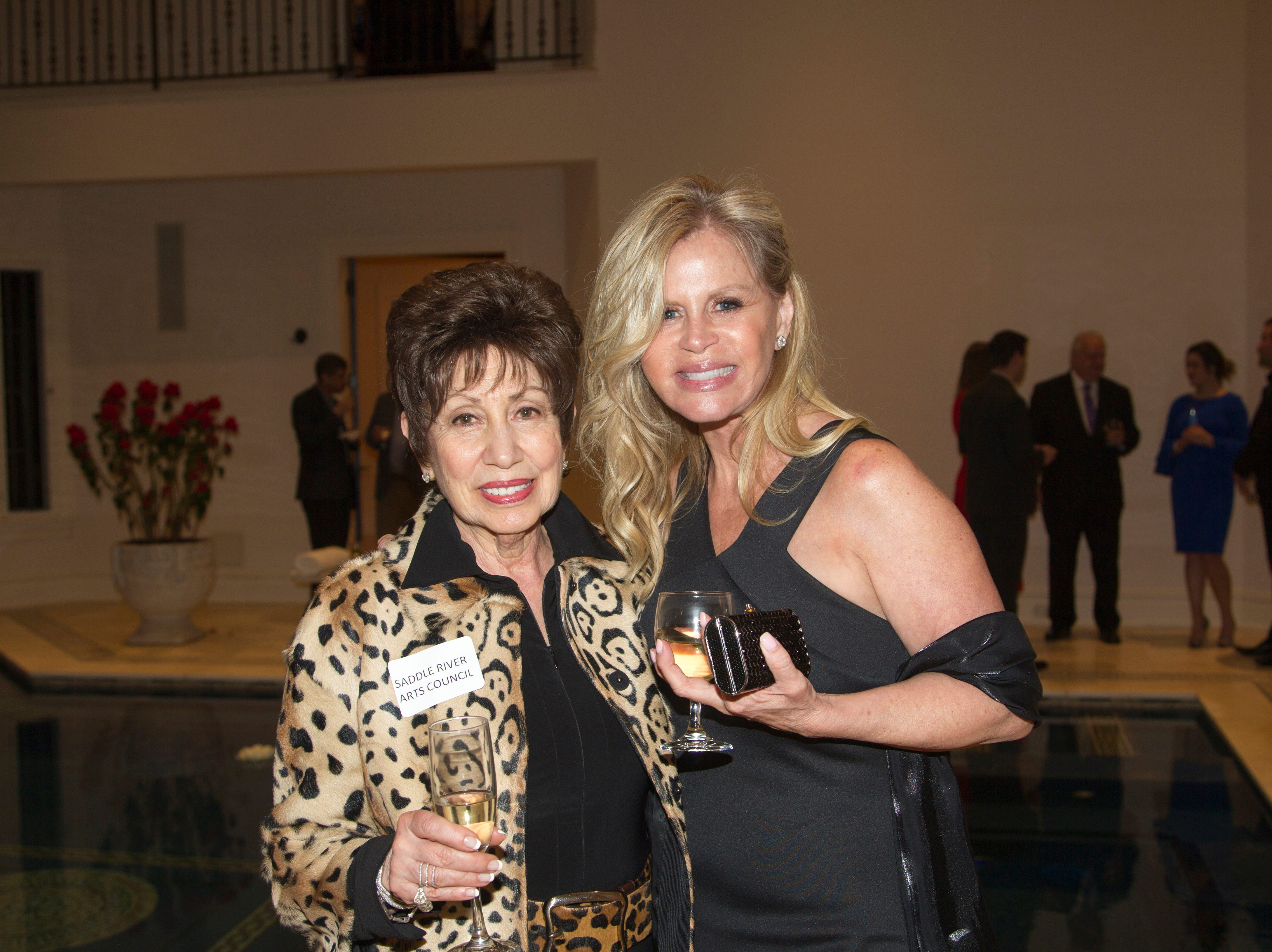 Vicki Gaily, Darcy Linares. Saddle River Arts Council presents An Evening of Giving Back featureing Eric Genuis in Saddle River. 03/30/2019