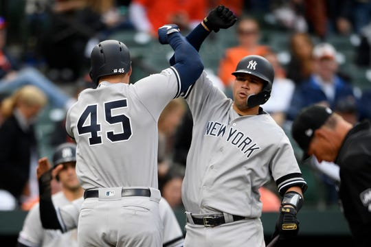 New York Yankees' Luke Voit (45) celebrates his three-run home run with Gary Sanchez, right, during the ninth inning of the team's baseball game against the Baltimore Orioles, Thursday, April 4, 2019, in Baltimore. The Yankees won 8-4.
