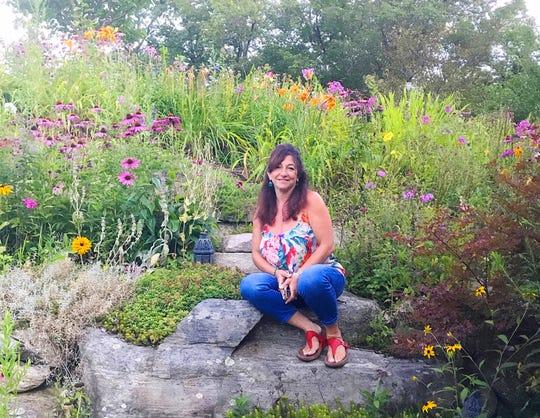 Karin LaGreca, Ramapo College professor of sustainability, says rain gardens capture storm water and filter runoff, protecting waterways from pollutants.