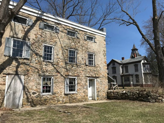 The Tenant House and the Seymour Smith House in the background are two of three buildings in Waterloo Village in Byram, N.J., as seen on April 4, 2019, set to receive a portion of a $3 million grant for site preservation.