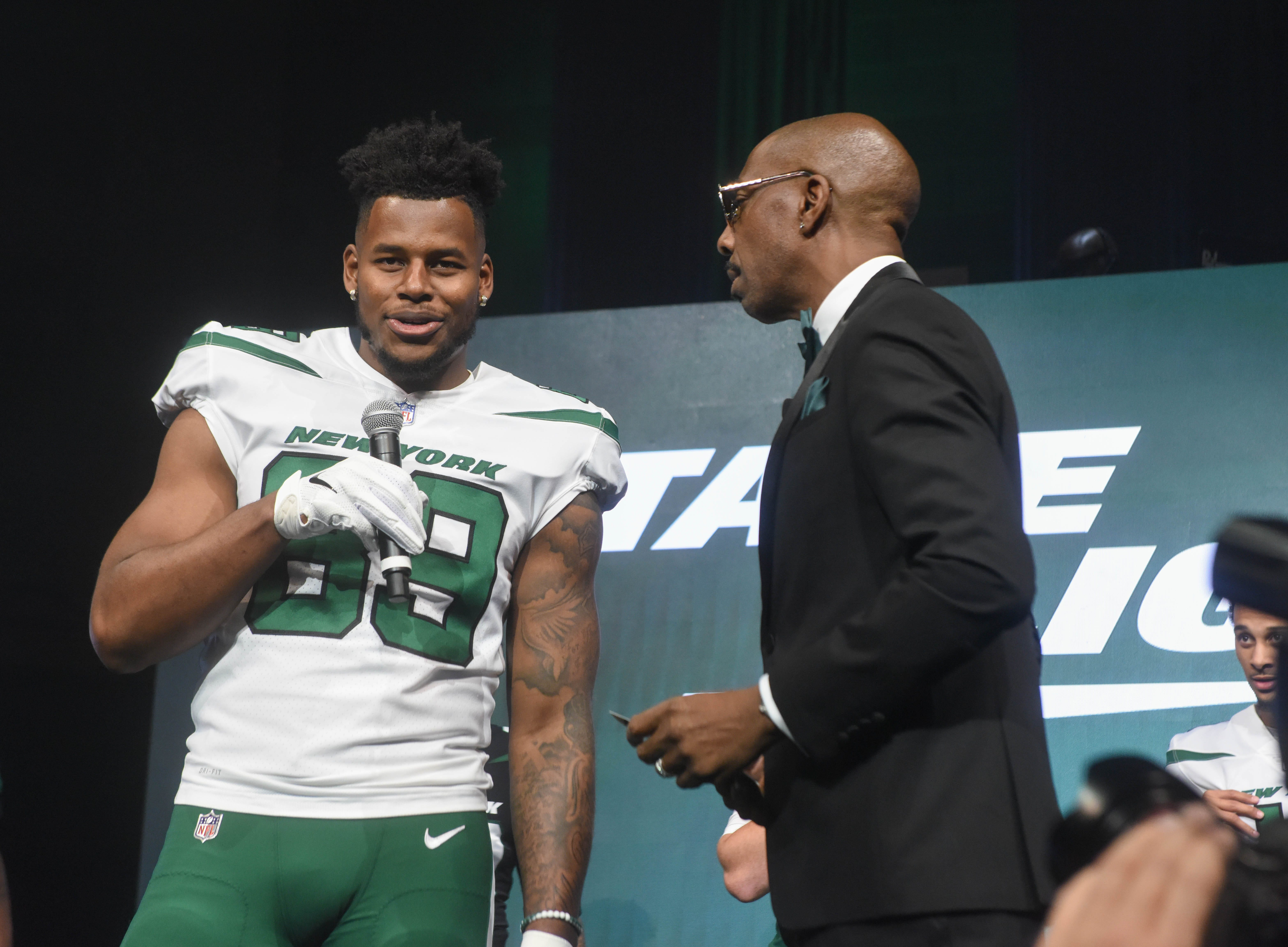 Chris Herndon (NY Jets) and J. B. Smoove (Comedian/Event Host).  The NY Jets unveiled their new football uniforms with an event hosted by JB Smoove at Gotham Hall in New York. 04/05/2019