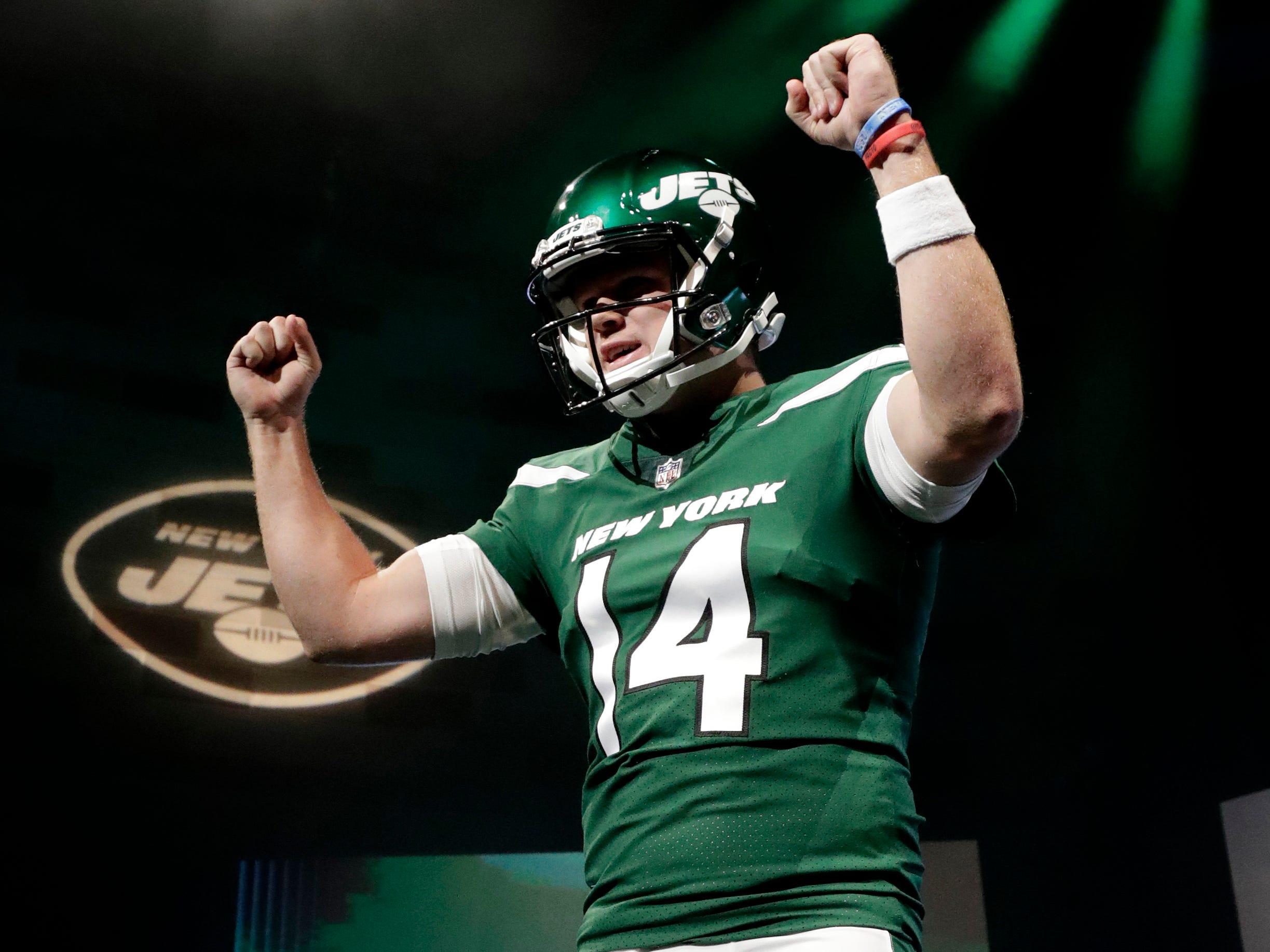 "New York Jets quarterback Sam Darnold models the NFL football team's new ""Gotham green"" uniforms Thursday, April 4, 2019, in New York. (AP Photo/Julio Cortez)"