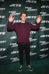 Sam Darnold and the Jets unveil their new football uniforms with an event hosted by JB Smoove at Gotham Hall in New York on April 5, 2019.
