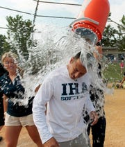 From 2012: IHA coach Anthony LaRezza  gets a bath from player Abby Holmes  after the Non-Public A softball championship at Toms River North High School.