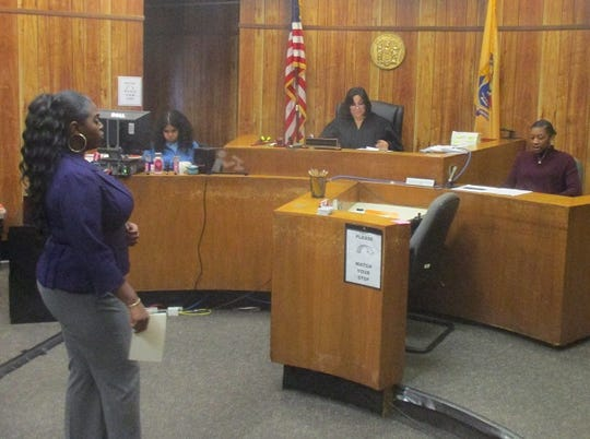 Rosa Parks sophomore Ronya Martin questions defendant (and classmate) senior Taniesha Gilbert before Judge Barbara J. Buono Stanton at the Paterson school district's first annual Spring Intermural Mock Trial Competition.