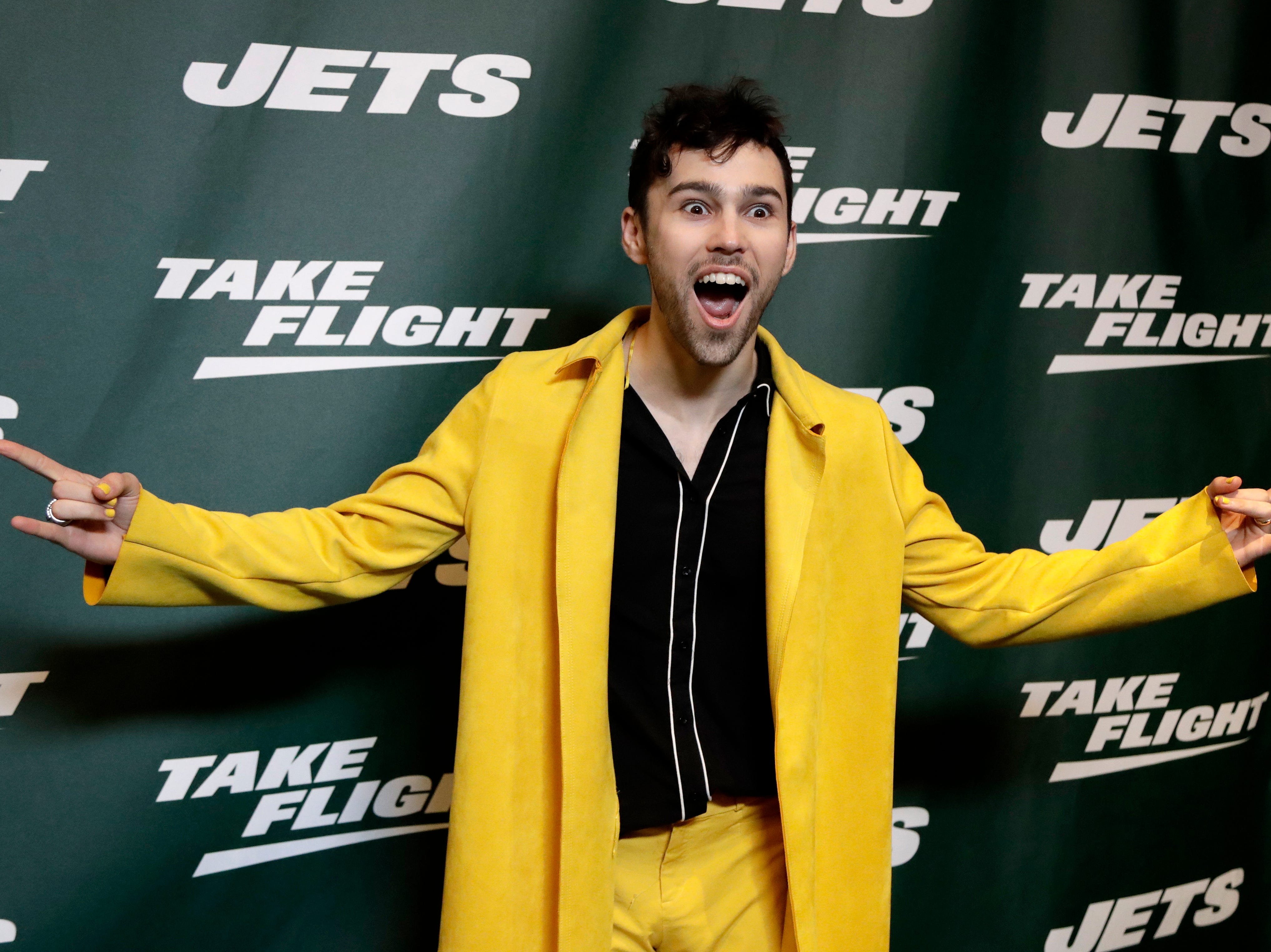Singer Max Schneider poses for photographers on the green carpet ahead of an event unveiling the New York Jets new NFL football uniforms, Thursday, April 4, 2019, in New York. (AP Photo/Julio Cortez)