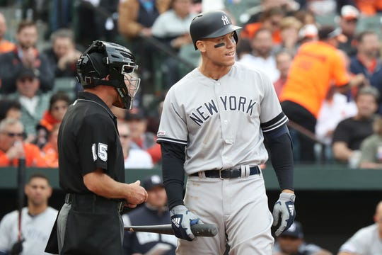 Apr 4, 2019; Baltimore, MD, USA; New York Yankees outfielder Aaron Judge (99) reacts after a called third strike against the Baltimore Orioles at Oriole Park at Camden Yards.