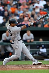 Gleyber Torres #25 of the New York Yankees hits a three run home run against the Baltimore Orioles in the sixth inning at Oriole Park at Camden Yards on April 04, 2019 in Baltimore, Maryland.
