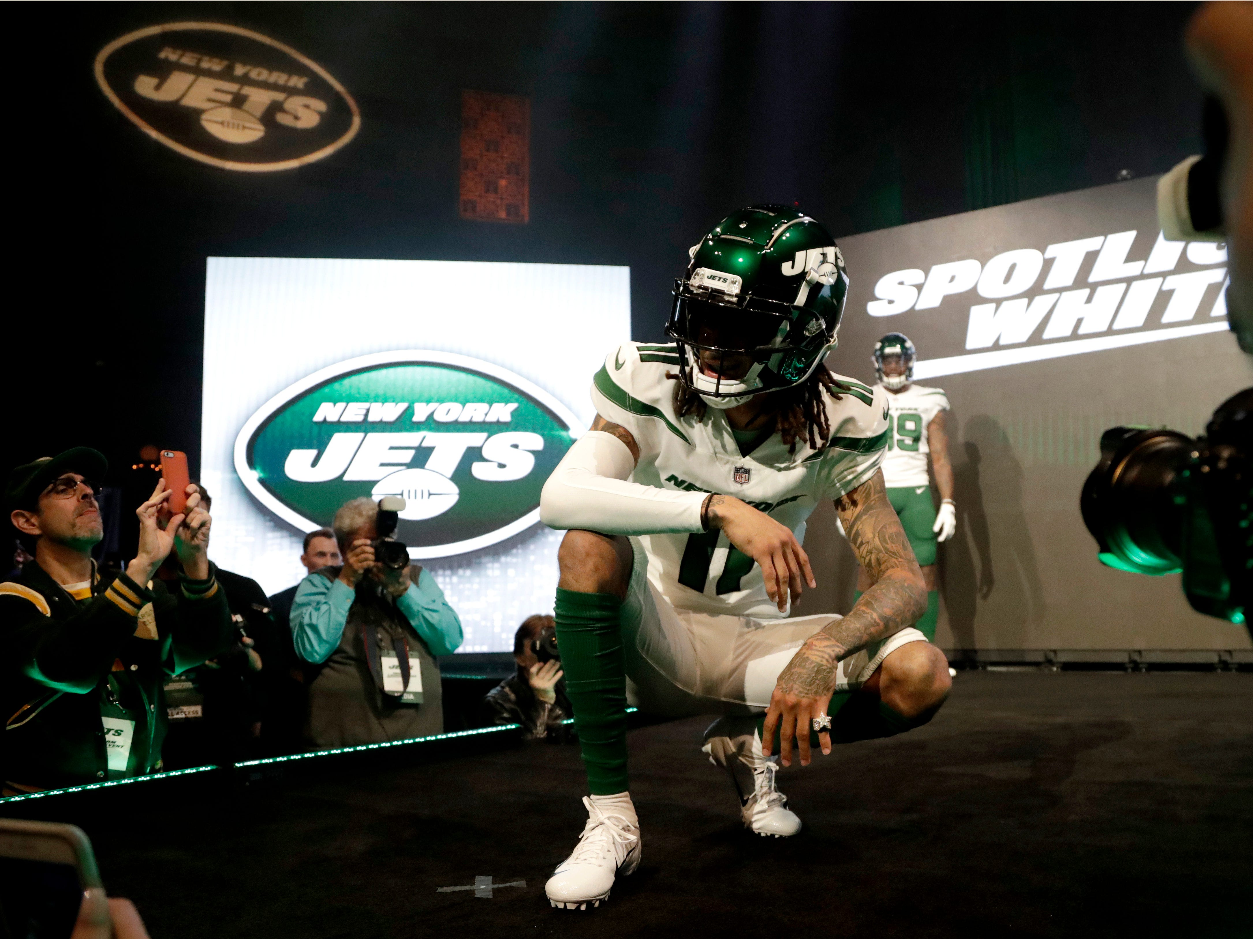 """New York Jets wide receiver Robby Anderson models the NFL football team's new """"spotlight white"""" uniform Thursday, April 4, 2019, in New York. (AP Photo/Julio Cortez)"""
