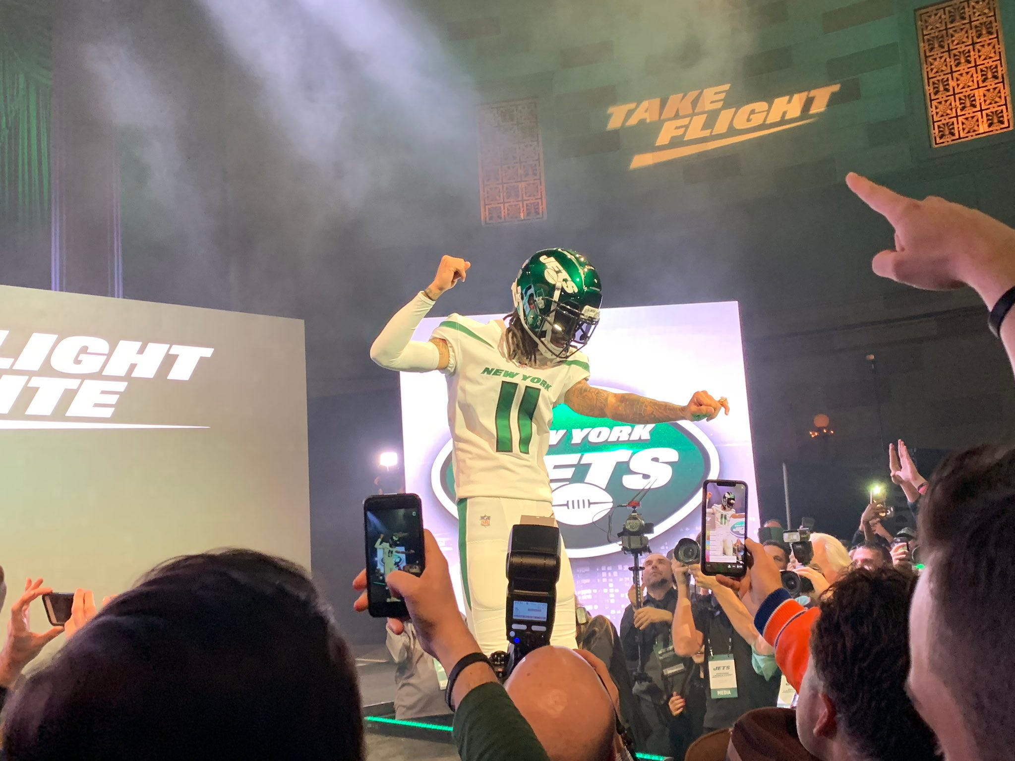 """Robby Anderson in the new road """"spotlight white"""" uniforms as he New York Jets unveiled the team's new uniforms on Thursday, April 4, 2019."""