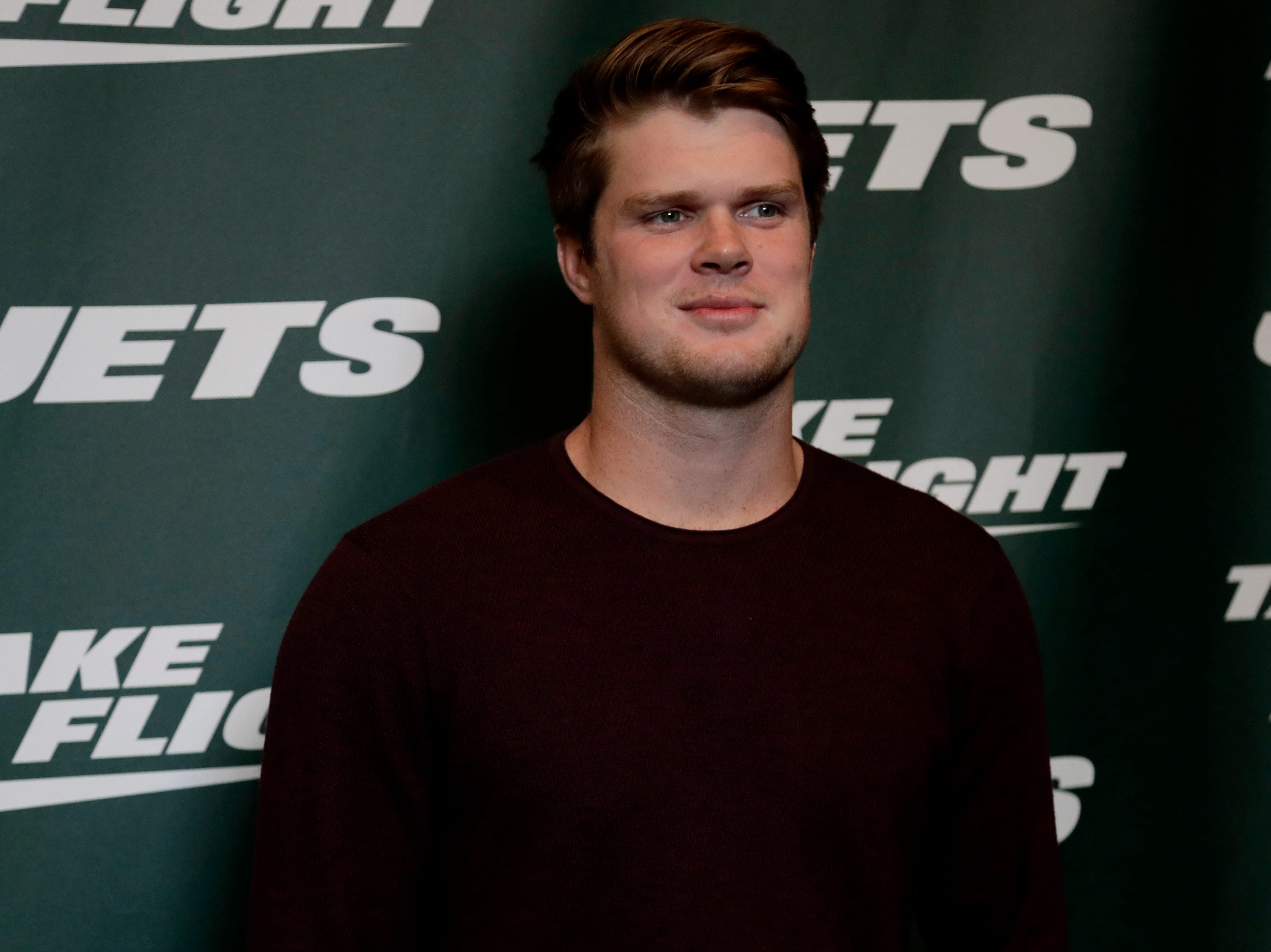 New York Jets quarterback Sam Darnold poses for photographers on the green carpet ahead of an event unveiling the NFL football team's new uniforms Thursday, April 4, 2019, in New York. (AP Photo/Julio Cortez)