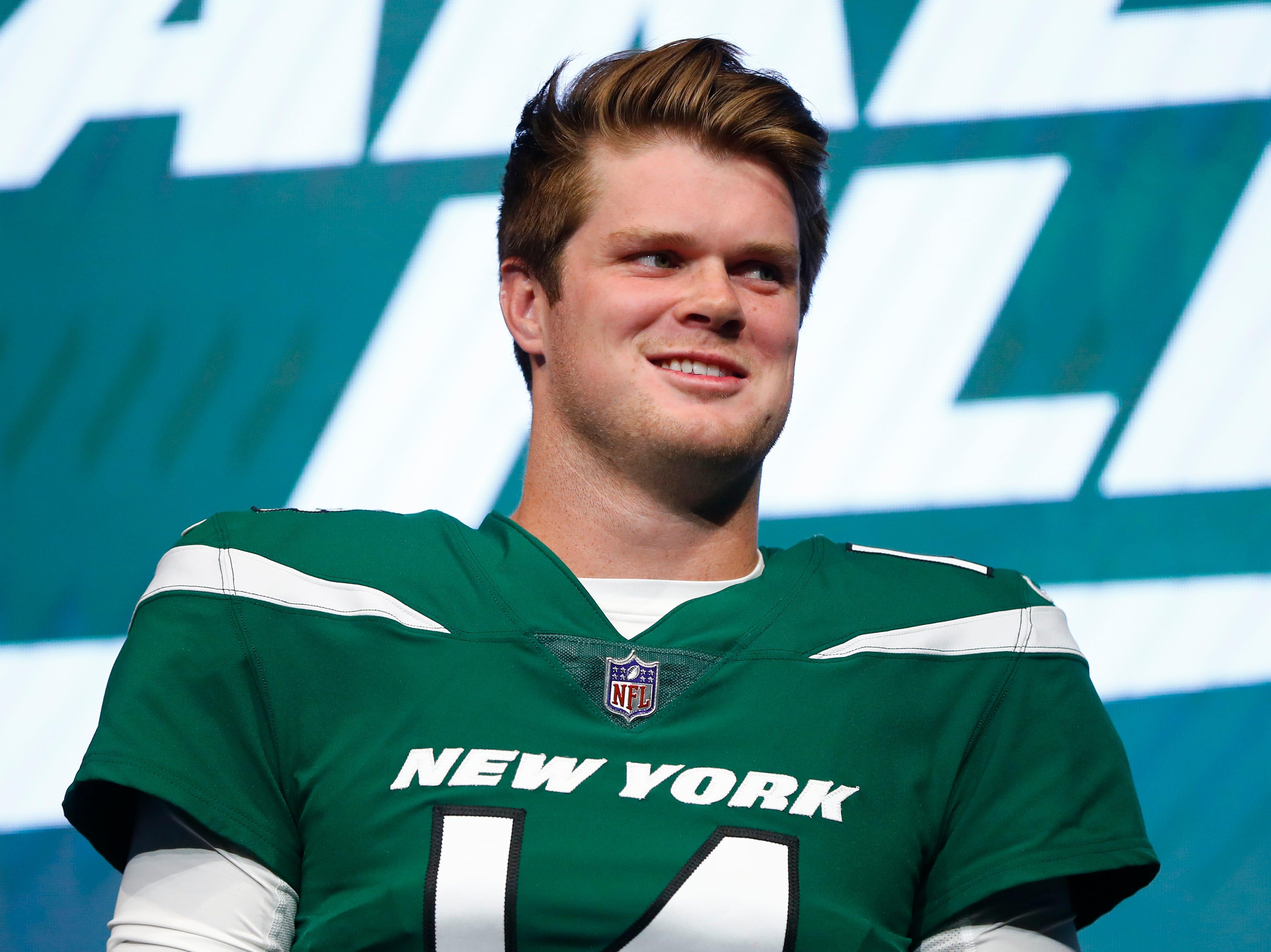 "New York Jets quarterback Sam Darnold models the NFL football team's new ""Gotham green"" uniform Thursday, April 4, 2019, in New York. (AP Photo/Julio Cortez)"