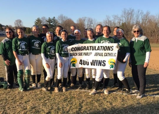 DePaul softball coach Sue Parler (right) celebrating her 400th career victory with  her team.