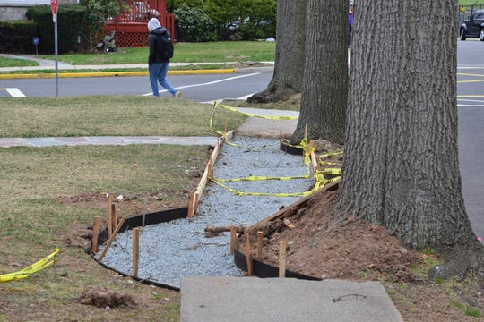 A large number of sidewalks are undergoing repairs on Cranford Place in Teaneack on Friday April 5, 2019.