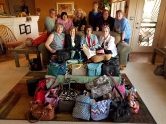 Members of the Omega Chapter of Delta Kappa Gamma filled 57 purses with toiletries,essentials and cosmetics for homeless women of the City of Hope April 1.