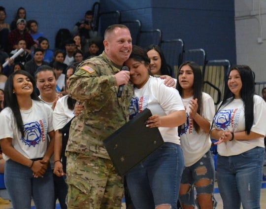 Captain Jason J. Kidd gives a big hug to his favorite Bulldawg softball player Dezi Rae Martinez.