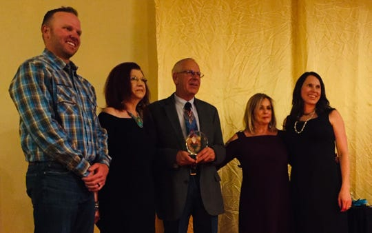 Greater Las Cruces Chamber of Commerce 2019 Citizen of the Year Rick Jackson, center, was presented an award Thursday, April 4, 2019, at the New Mexico Farm and Ranch Heritage Museum. From left are Chamber Board President Jake Redfearn (NAI 1st Valley), Chamber CEO Debbi Moore, Rick Jackson (American Document Services), his wife Linda Jackson (The Chocolate Lady); and their daughter April Tate (American Document Services). Tate also won an award Thursday, taking home Conquistador of the Year.