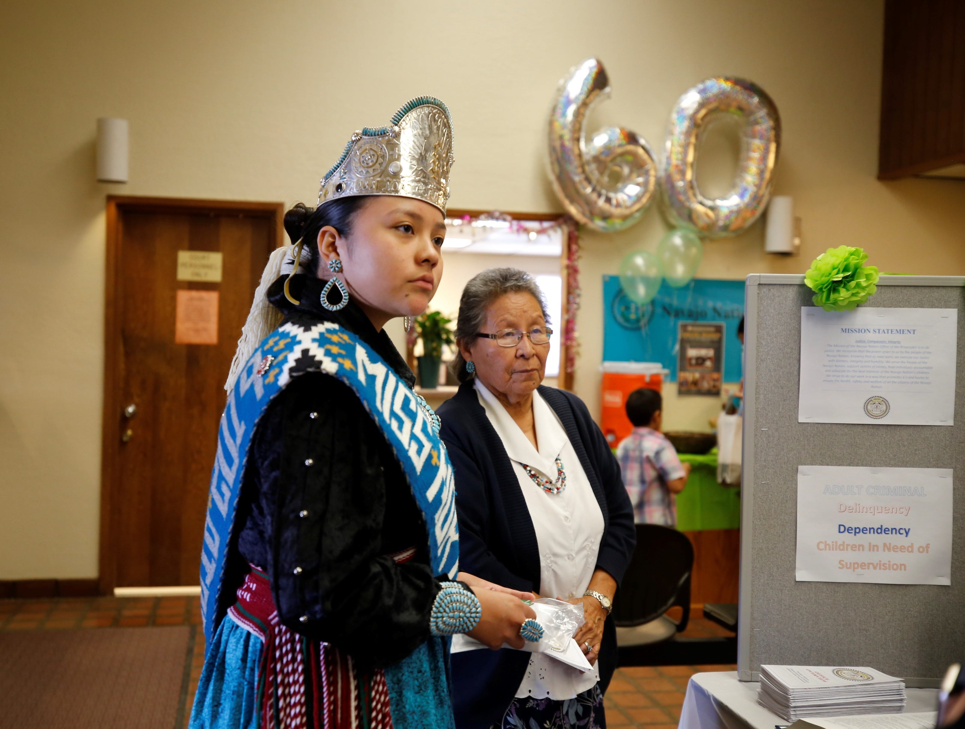 Miss Northern Navajo Teen Tehya Barber listens to information about the tribe's Office of the Prosecutor on Friday at Justice Day at the Shiprock Judicial District court.